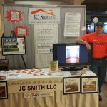 men standing at booth for JC Smith LLC