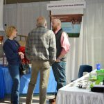 people talking at booth for Mountain Man Handyman Services