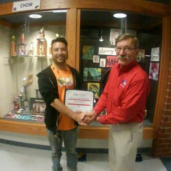 Jesse Dustin receiving Katy Fidler Scholarship Award from Bill Courtemanche